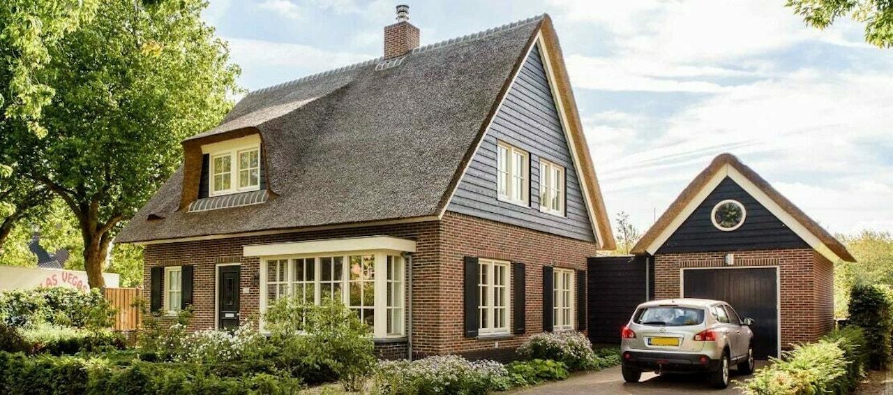 Een gerealiseerde woning met een Cape Cod topgevel en een levensloopbestendige indeling